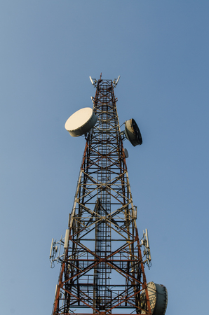 Telecommunication tower and blue sky. Stock Photo