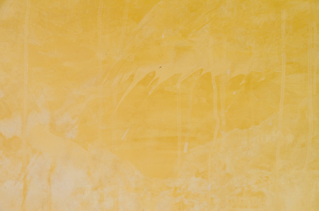 textured wall: Yellow grunge cement wall, textured background