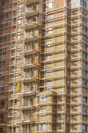 Building construction site with scaffolding Stock Photo