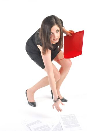 picking up: annoyed secretary crouching with papers