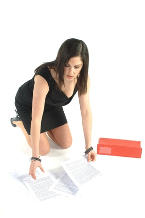 picking up: secretary kneeling with papers