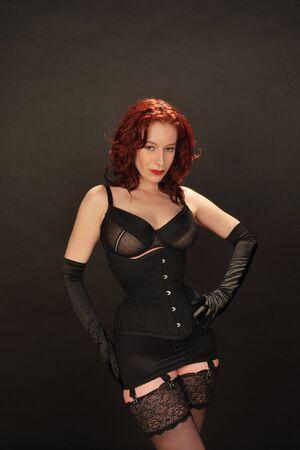 mujer de pelo roja en ropa interior retro Foto de archivo - 9187443