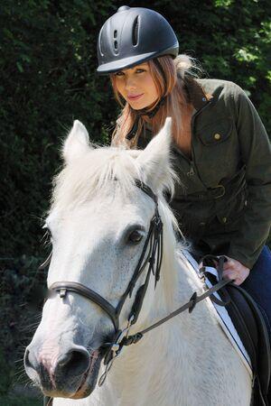 Pretty girl on horse Stock Photo