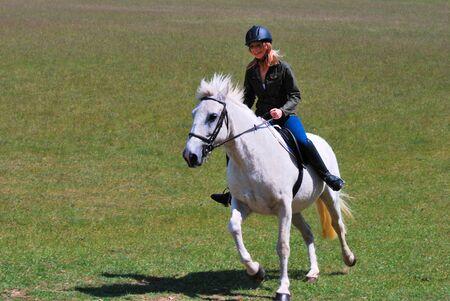 Pretty girl on white horse photo