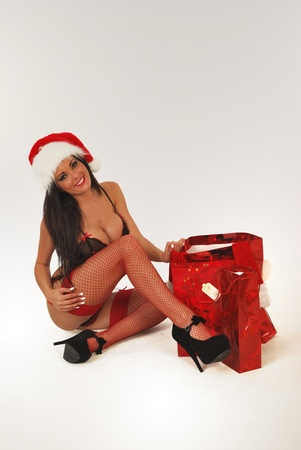 sexy santa sitting with gifts