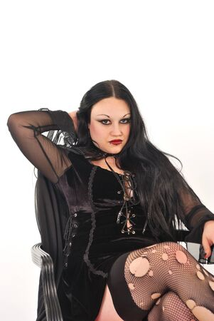 Gothic girl sitting in stockings photo