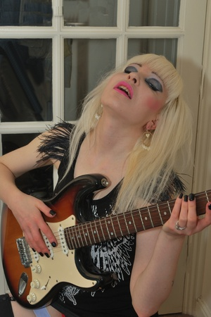Sexy blonde playing guitar photo