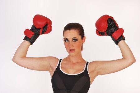 female boxer raising arms in triumph Stock Photo - 11839103