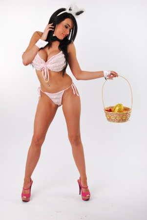 bunny girl standing with easter basket photo