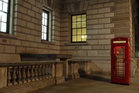 Red telephone box by night photo