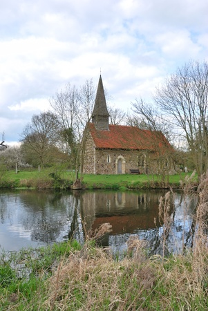 english countryside: small church by river