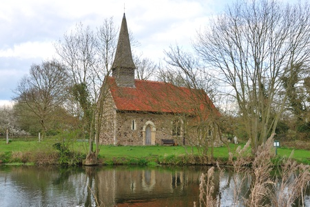small church by river photo