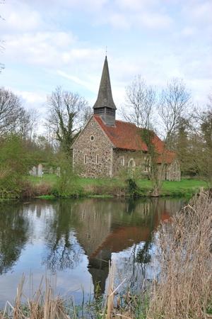 小さな教会の川に反映 写真素材