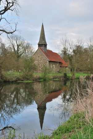 english church by canal photo
