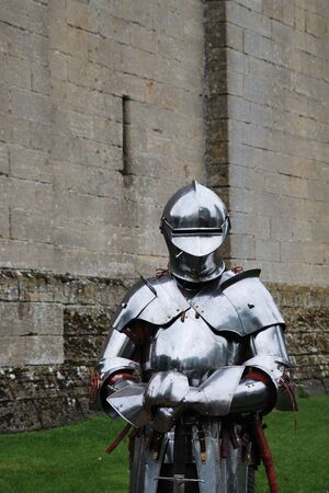 Knight in armour in front of castle Stock Photo