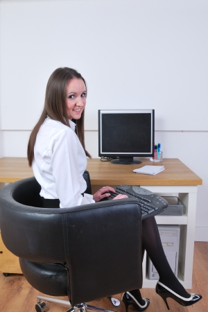sexy secretary sitting at screen photo