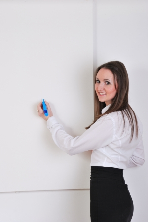 Businesswoman with blank whiteboard in portrait view photo