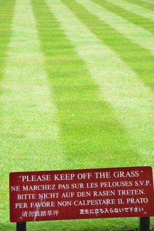 multilingual: Multilingual keep off the grass sign Stock Photo