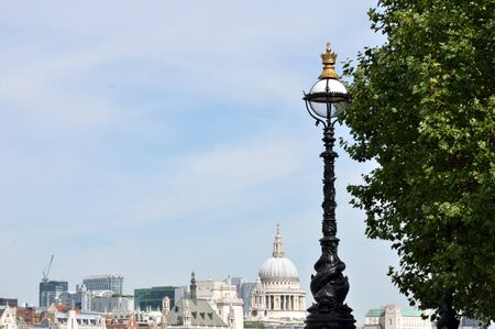 street lamp with london in background photo