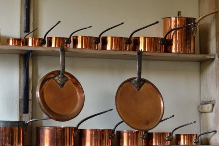 rows of copper pots Stock Photo