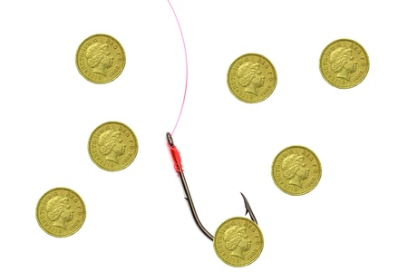 Pound Coin as bait with other coins Stock Photo - 16400695