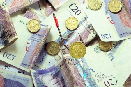 pound coin bait  over bed of money Stock Photo - 16400810