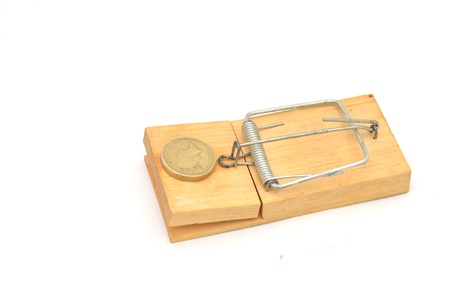 mousetrap with pound coin Stock Photo - 16400817
