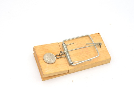 mousetrap at angle with 5 pence coin Stock Photo - 16400847