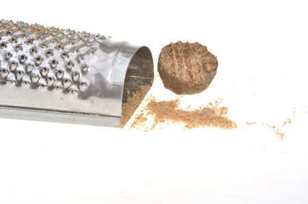 Close up of nutmeg with grater Stock Photo - 17583296