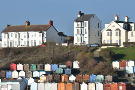 View of Beach huts and houses at Walton on Naze photo
