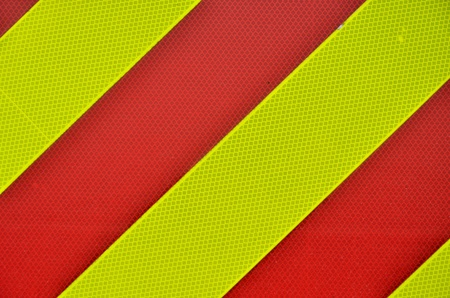Yellow and red diagonal High Visibility Stripes photo