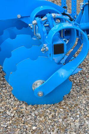 harrow: Blue Harrow Discs Stock Photo