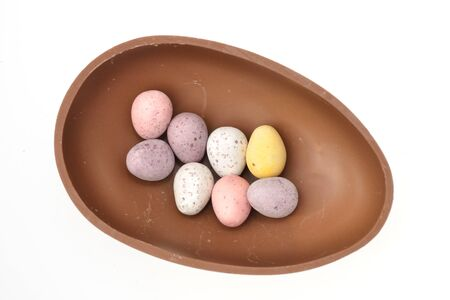 Group of small eggs in chocolate shell photo