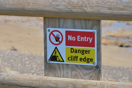 Cliff edge danger sign photo