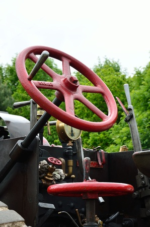 Steering wheel of traction engine photo