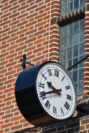 Old clock with brickwork photo
