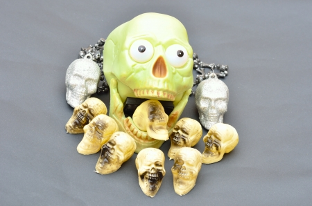 Skull gnawing on skulls photo