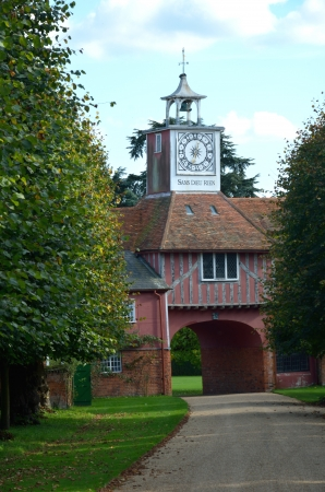 gatehouse: Gatehouse and clock through trees