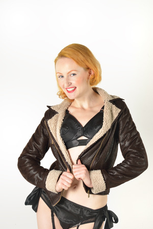 Pretty red head in flying jacket photo