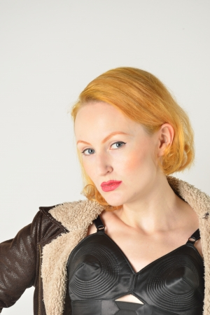 Portrait of red head in retro leather jacket photo