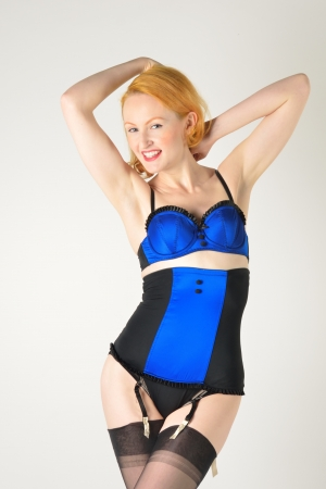 Retro model in blue underwear with arms raised photo
