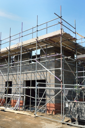 scaffold: House being built in portrait Stock Photo