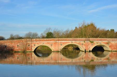 redbrick: Large arched redbrick river bridge in suffolk
