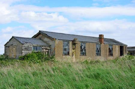 derelict: Derelict brick air field building