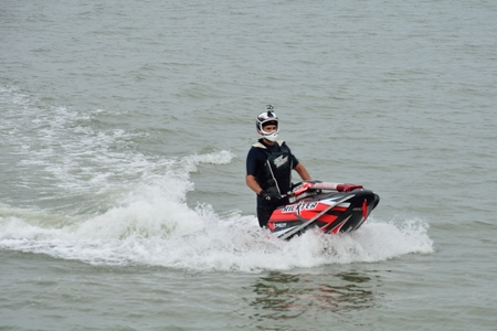 jet skier: St LAWRENCE BAY ESSEX UK  17 May 2014– jet skier in wet suit