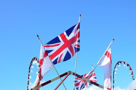 Union jack and english flags flying photo