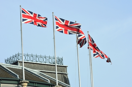 jacks: Union Jacks on Building Stock Photo