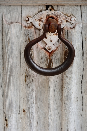 Ancient rusty door knocker photo
