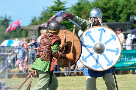 blackwater: Blackwater Country Fare MALDON ESSEX UK 22 June 2014:  Two Vikings fighting with sword and shields Editorial