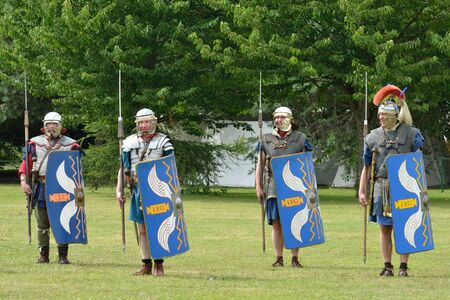 roman soldiers: Military Tattoo  COLCHESTER ESSEX UK 8 July 2014:   Roman soldiers in parade drill